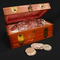 1018791_treasure_chest_and_silver_dollars_